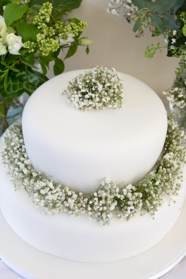 White wedding cake decorated with babies breath