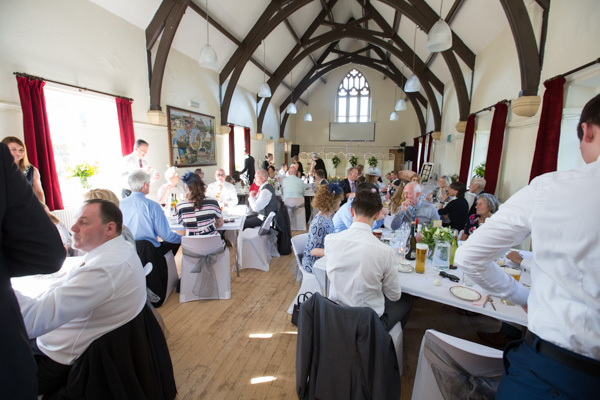 Guests during the wedding breakfast at Cawthorne Village Hall