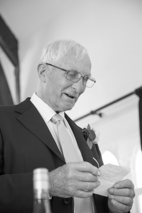 Bride's father giving a speech in black and white at Cawthorne Village Hall