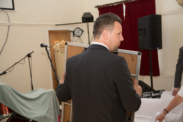 Groom helping to rearrange the room at Cawthorne Village Hall