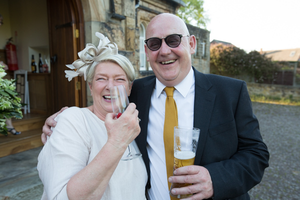 Wedding Guests enjoying the weather outside Cawthorne Village hall