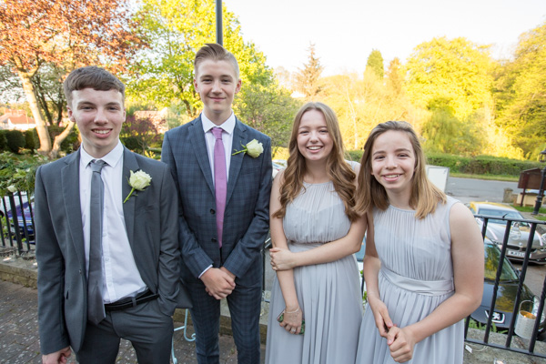 Bridesmaids and groomsmen outside cawthorne village hall