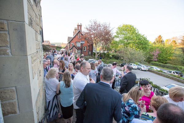 Wedding Guests standing outside Cawthorne Village Hall