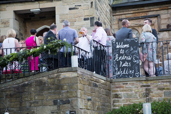 View of Cawthorne Village Hall from the car park with Andres and Kates wedding welcome sign