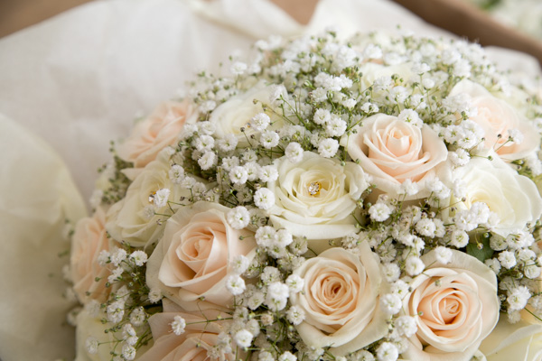Pink and white rose bridal bouquet with gypsophillia