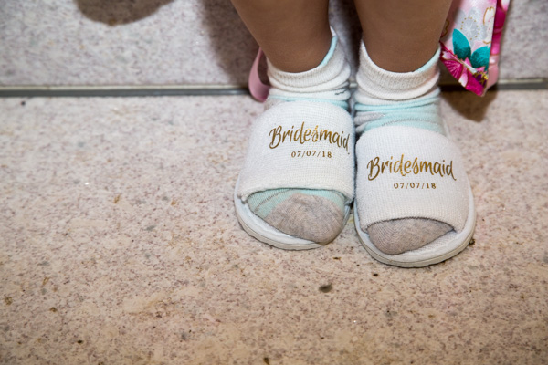 Child wearing personalised bridesmaid slippers with socks Barnsley wedding photography