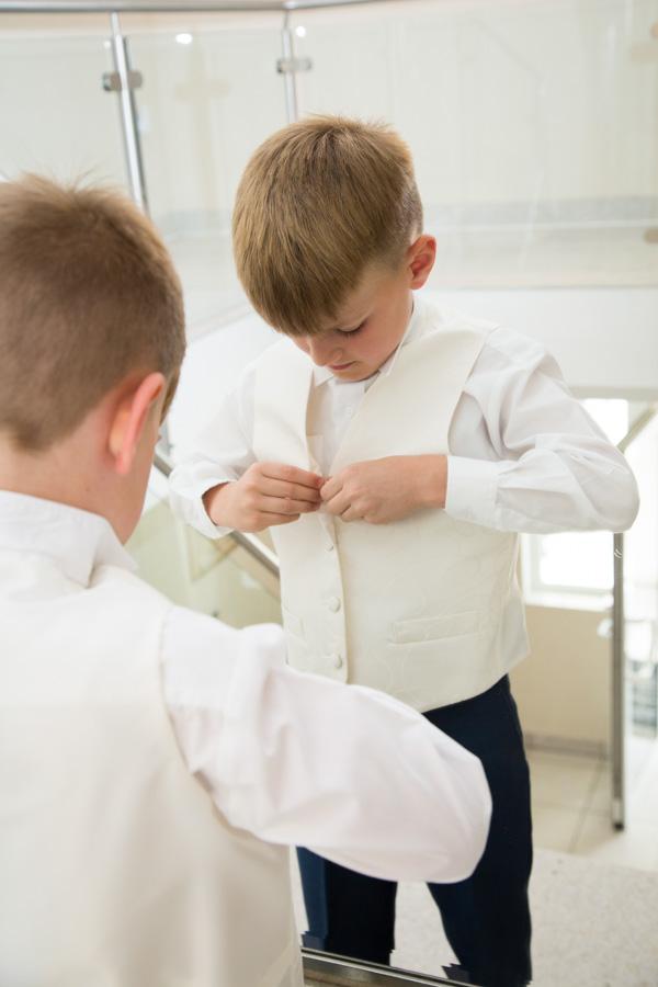 Best Man fastening his waistcoat