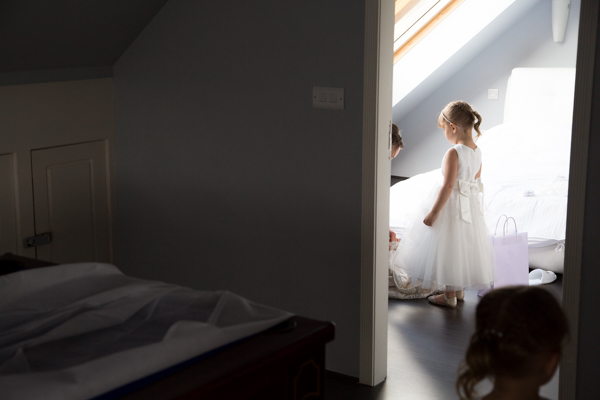 Bride,helping little bridesmaid with her shoes Barnsley wedding photography