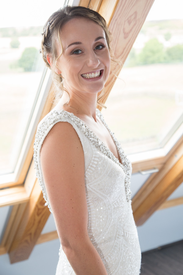 Bride smiling on the top floor of the house before the wedding at Barnsley Town hall
