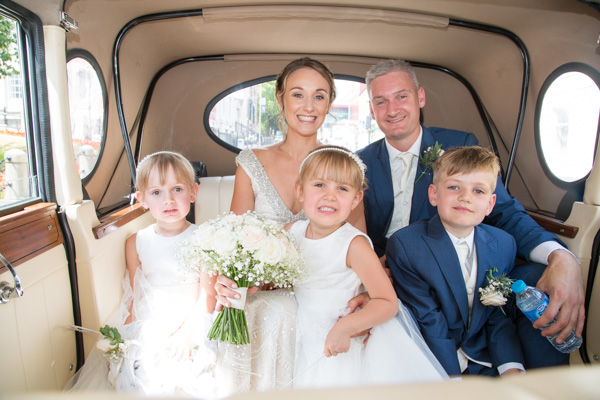Bride and Groom with their children in the wedding car Barnsley wedding photography