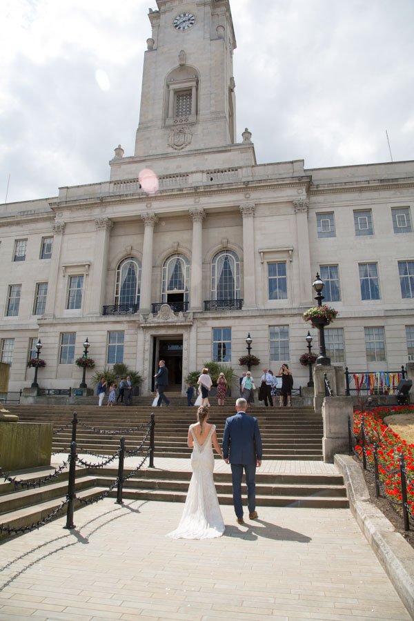 Bride and Groom walking to Barnsley Town Hall for their wedding