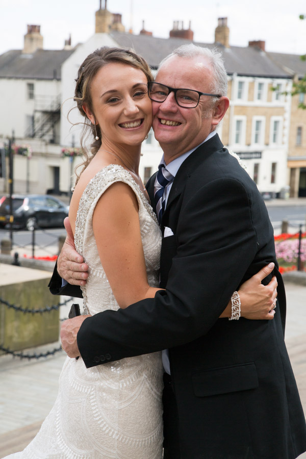 Bride with her dad outside Barnsley town hall on her wedding day