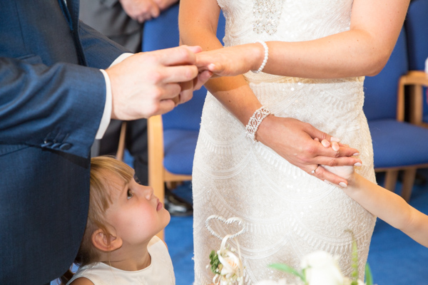 Bride and Groom exchanging rings with their twin girls watching closely Barnsley wedding photography