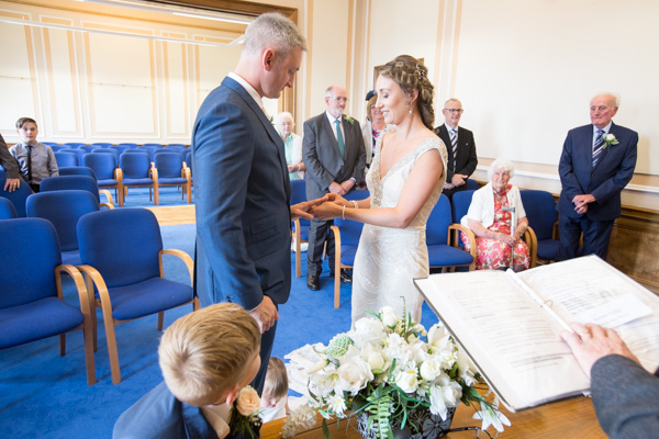 Bride and Groom exchanging rings at Barnsley Town Hall Wedding
