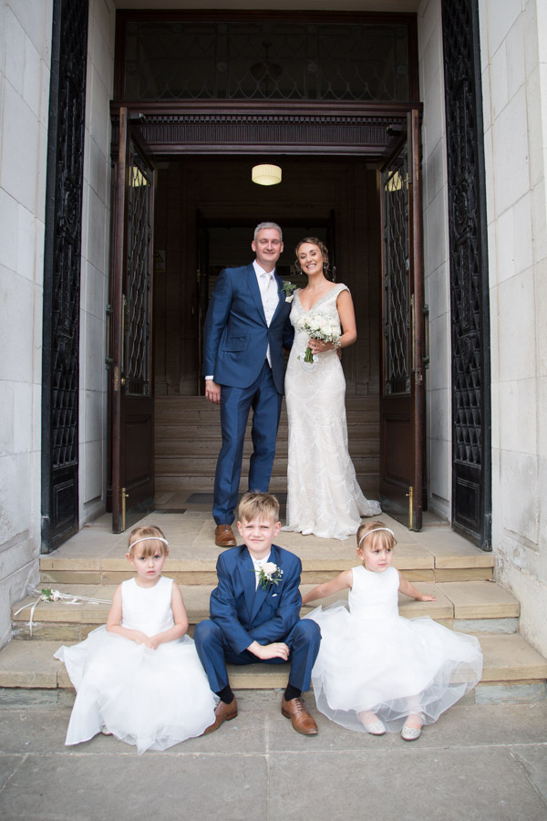 Bride and Groom with their children at the entrance to Barnsley Town Hall
