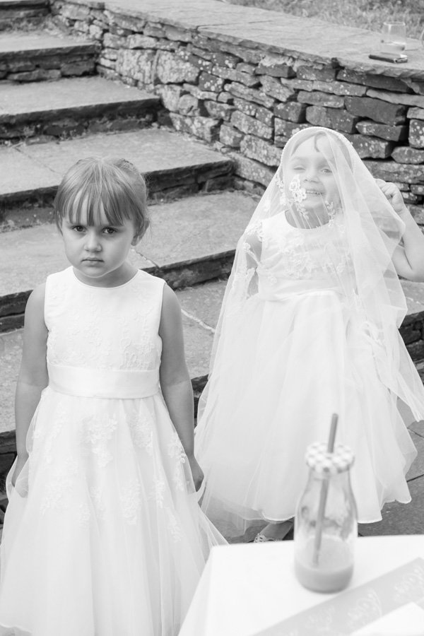 Bridesmaids playing with their dresses in the back garden on the wedding day Barnsley wedding photography