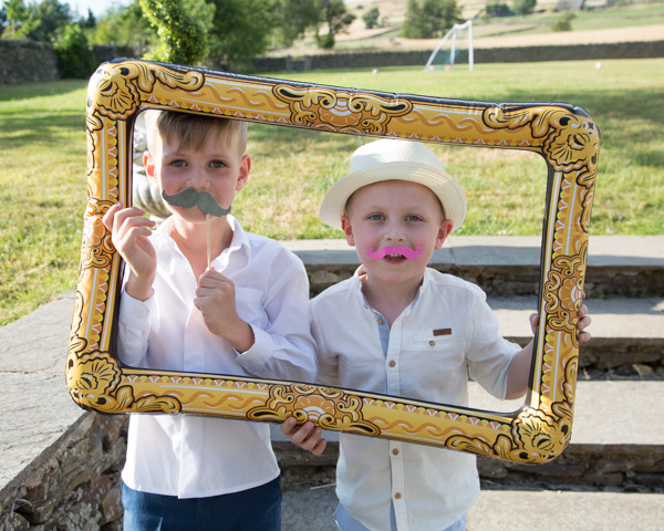Kids playing with photo booth props