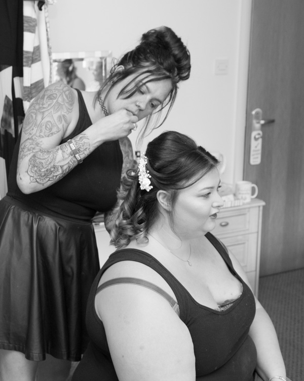 Bridesmaid having her hair done at Burntwood Wedding