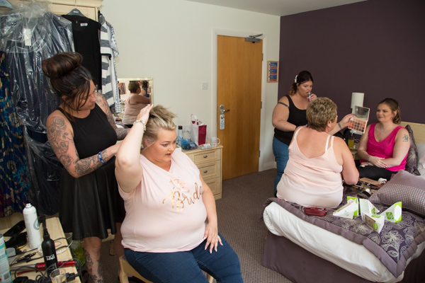 Bride and bridal party getting ready in a Burntwood court hotel room