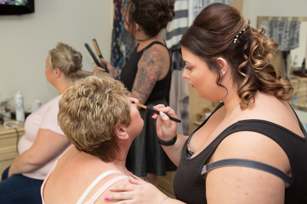 Bridal party with makeup artist and hairdresser at Burntwood wedding