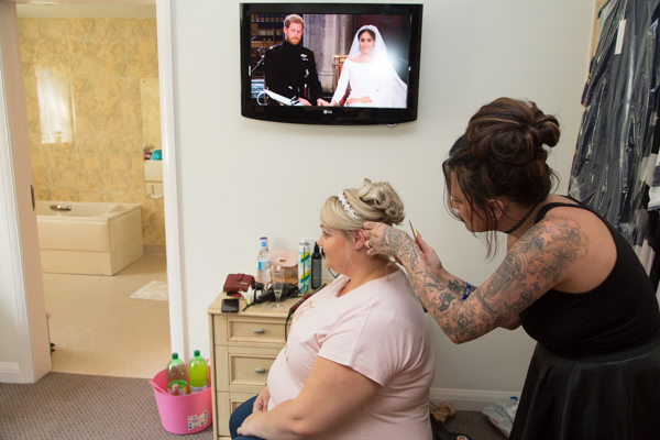 Bride with her hairdresser with the Royal Wedding playing in the background