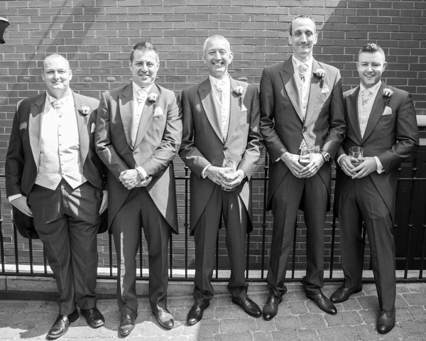 Groom and Groomsmen outside The Burntwood bar with a pint each on the morning of the wedding