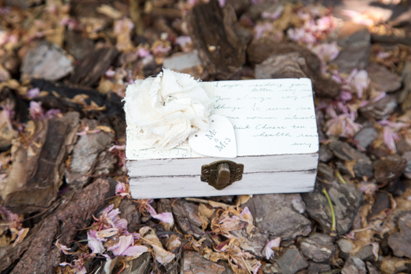 A distressed wooden wedding ring box personalised with the couples initials
