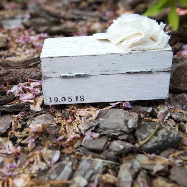 A distressed wooden wedding ring box personalised with the couples wedding date
