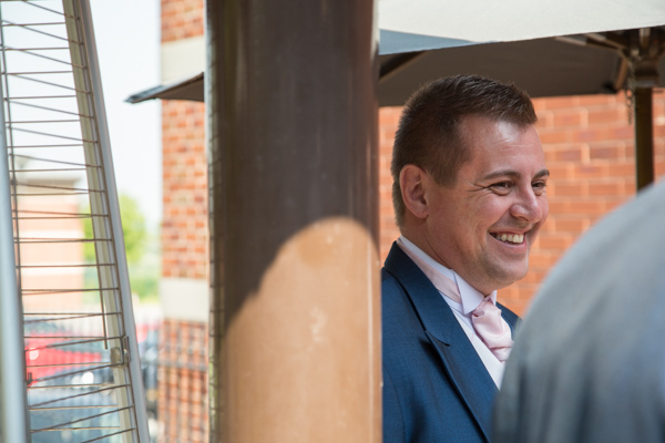 Groomsman laughing outside The Burntwood wedding.