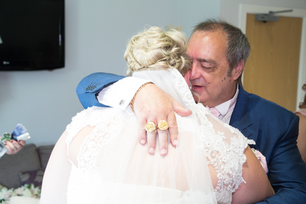 Bride and father of the Bride hugging on the wedding day at Burntwood