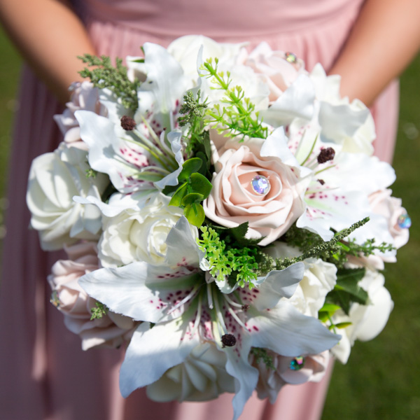 Bridesmaids bouquets with lilies roses and diamante