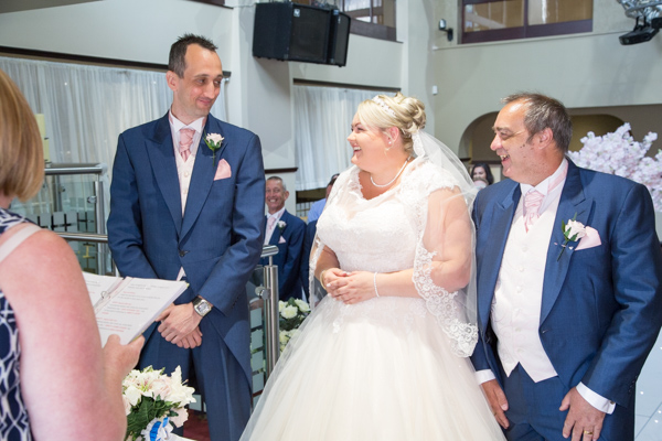 Bride, Groom and Father of the Bride at the top of the aisle in the Qube Burntwood wedding