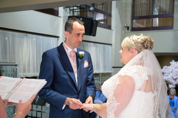 Bride and Groom saying their vows in the Qube at Burntwood Court Hotel