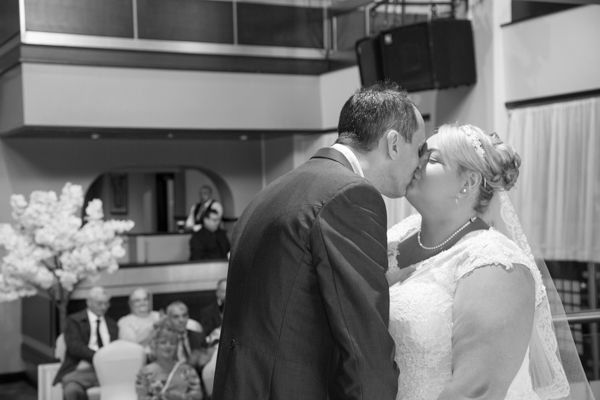 Bride and groom kiss after their wedding ceremony at Burntwood court hotel wedding