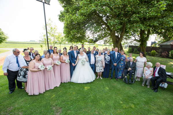 Bride and Groom with full wedding party at Burntwood Court Wedding