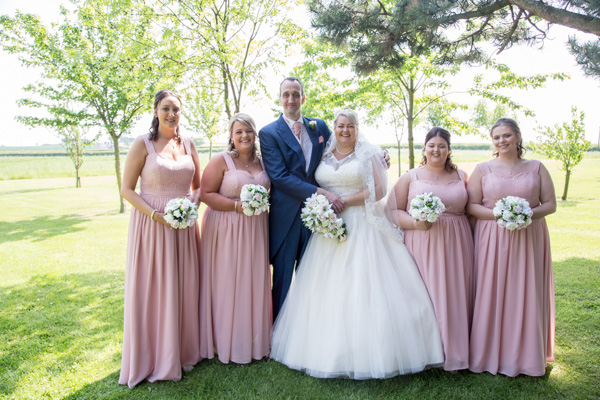Bride and Groom with Bridesmaids outside Burntwood Court Wedding
