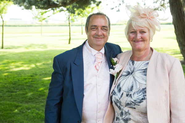 Parents of the bride outside Burntwood Court Hotel