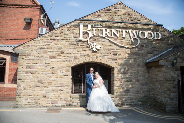 Bride and Groom outside Burntwood sign at the Qube wedding
