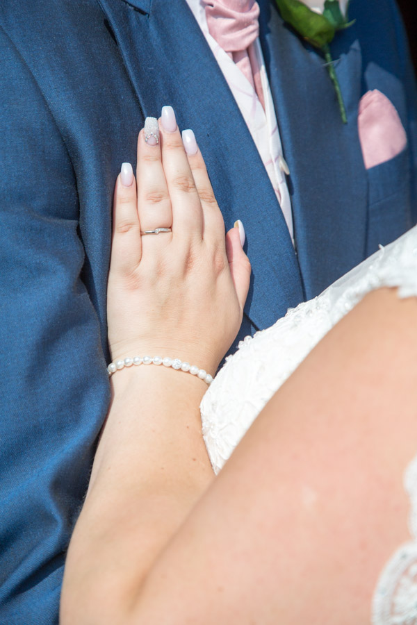 The brides wedding ring on the Grooms suit