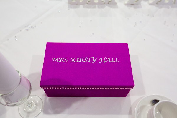 Pink glitter box with brides name written in diamantes