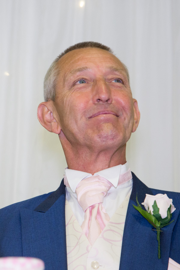 Father of the Groom smiling at the top table at Burntwood Court Hotel Wedding