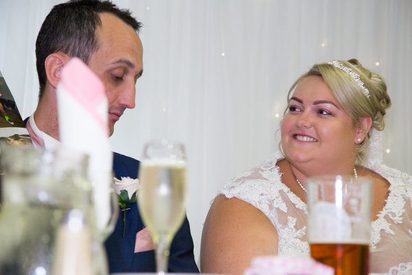 Bride smiling at groom during Burntwood Court Hotel wedding