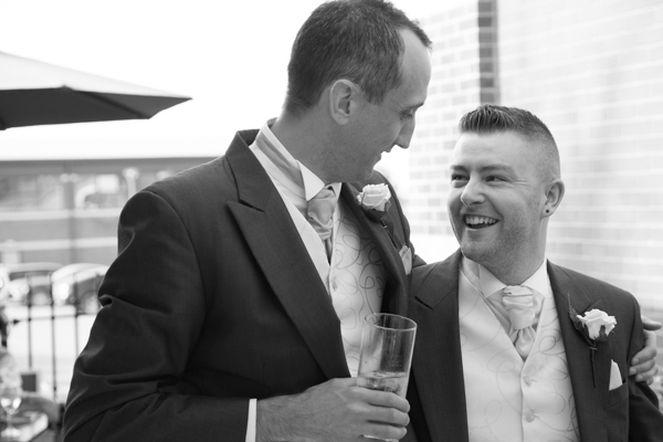 Groom laughing with Best Man outside Burntwood court Hotel