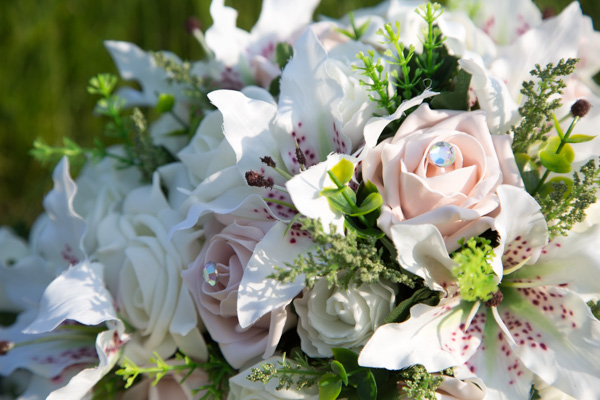 Brides bouquet with pink roses and diamante centres