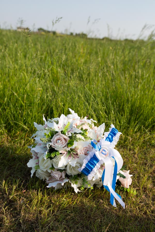 Brides bouquet with Sheffield Wednesday Garter tied around the stem