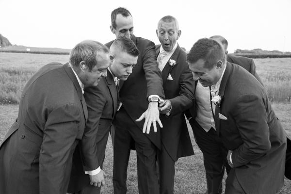 Groomsmen admiring Grooms ring