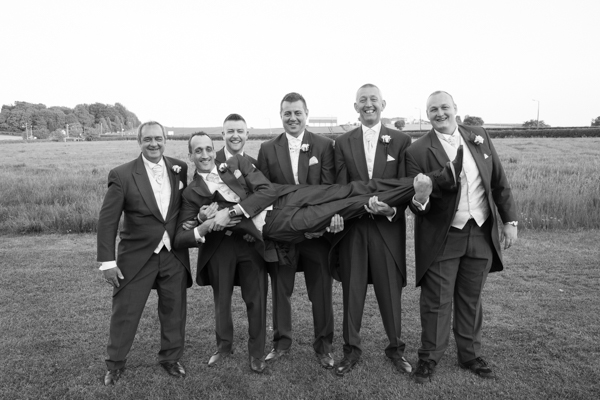 Groomsmen carrying Groom at Burntwood Court Hotel Wedding