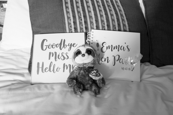 Plush Sloth toy with memory books on the bed at Tankersley Manor Wedding