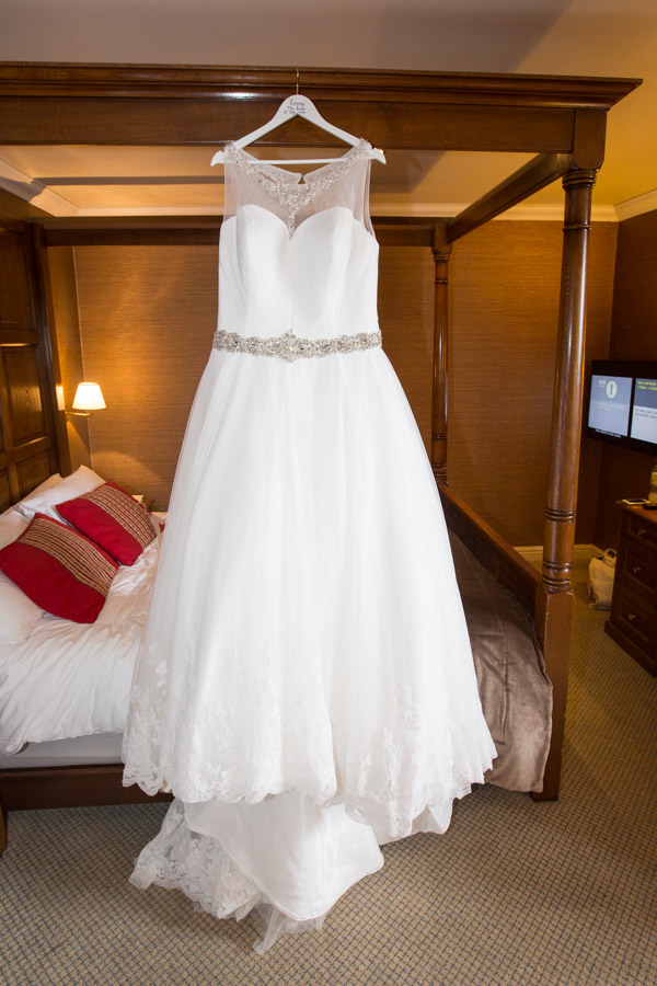 Wedding dress from the Wedding Date hanging before it's worn at Tankersley Manor wedding