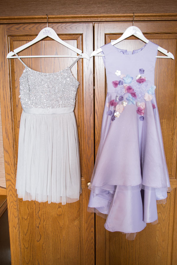 Bridesmaid dresses hanging on the wardrobe at Tankersley Manor